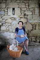 Portrait of Paulette Borde with the prized Tarbais beans used in the cassoulet that she grows locally