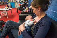 A mother breastfeeds her 5 month old son at a play centre.<br /> <br /> Hampshire, England, UK<br /> 21/03/2016<br /> <br /> &copy; Paul Carter / wdiip.co.uk