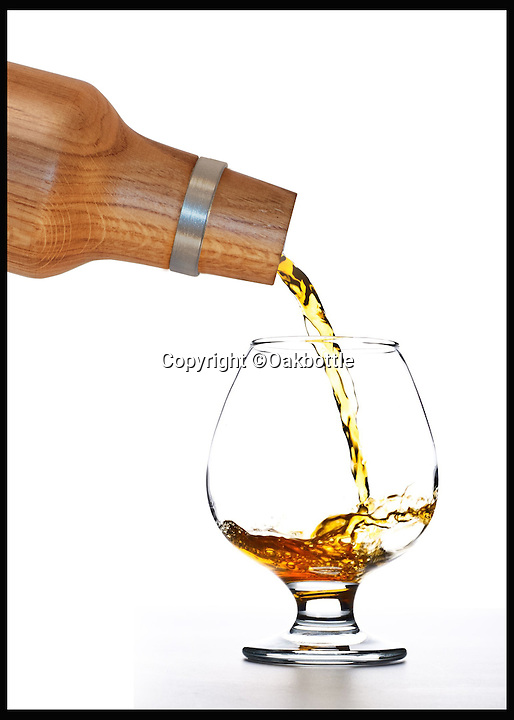 BNPS.co.uk (01202 55883)<br /> Pic: Oakbottle/BNPS<br /> <br /> *Please use full byline*<br /> <br /> The Oakbottle., pouring a drink.<br /> <br /> This simple wooden bottle could be about to change the face of the lucrative drinks industry - because it promises to turn cheap booze into more expensive vintage-tasting drinks.<br /> <br /> The oak bottle replicates the ageing process of wines and spirits during which they sit in oak barrels and develop their flavour - but instead of taking months or years its makers say it takes as little as 24 hours to achieve the same effect.<br /> <br /> It means drinks lovers could potentially enjoy the oaky flavours of premium tipples without having to fork out the high prices they demand.  <br /> <br /> The original Oak Bottle, made from sustainably sourced American oak, costs $79.99 - around &pound;50 - from oakbottle.com.