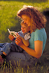 mother and toddler reading outdoors