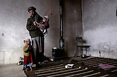 Kabul, Afghanistan<br /> November 21, 2001<br /> <br /> A refugees family from Mazar-e-Sharif and who have lived in Kabul for the past 5 year live now in an abandon buildings in Kabul.