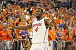 UF junior center Patric Young encourages the crowd to cheer during the second half of the University of Kentucky vs. University of Florida men's basketball game at the O'Connell Center in Gainesville, Fl., on Tuesday, February 12, 2013. UK lost 69-52. Photo by Tessa Lighty | Staff