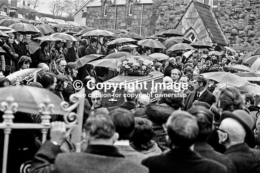 Funerals of victims of the Kingsmill massacre on January 5, 1976, when 10 Protestants were killed in South Armagh, Northern Ireland, by members of the Provisional IRA  using the cover name &quot;South Armagh Republican Action Force&quot;. Victims were textile workers returning home to Bessbrook in a Ford Transit mini-bus along the Whitecross to Bessbrook road.  Ref: 197601080024A.<br /> <br /> Copyright Image from Victor Patterson, 54 Dorchester Park, <br /> Belfast, UK, BT9 6RJ<br /> <br /> t1: +44 28 9066 1296 (from Rep of Ireland 048 9066 1296)<br /> t2: +44 28 9002 2446 (from Rep of Ireland 048 9002 2446)<br /> m: +44 7802 353836<br /> <br /> e1: victorpatterson@me.com<br /> e2: victorpatterson@gmail.com<br /> <br /> www.victorpatterson.com<br /> <br /> Please see my Terms and Conditions of Use at www.victorpatterson.com. It is IMPORTANT that you familiarise yourself with them.<br /> <br /> Images used on the Internet must be visibly watermarked i.e. &copy; Victor Patterson within the body of the image and copyright metadata must not be deleted. Images used on the Internet have a size restriction of 4kbs and will be chargeable at current NUJ rates unless agreed otherwise.<br /> <br /> This image is only available for the use of the download recipient i.e. television station, newspaper, magazine, book publisher, etc, and must not be passed on to any third party. It is also downloaded on condition that each and every usage is notified within 7 days to victorpatterson@me.com<br /> <br /> The right of Victor Patterson to be identified as the author is asserted in accordance with The Copyright Designs And Patents Act (1988). <br /> com