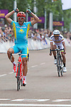 Mcc0041438 . Daily Telegraph..DT Sport..Kazakhstan's Alexandr Vinokourov wins the Olympic Mens Road Race on The Mall with Colombia's Rigoberto Uran, a Team Sky colleague of Cavendish's, following closely behind..28 July 2012.