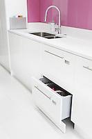 The sleek design of the kitchen ensures that there are many beautifully fitted drawers and cupboard doors