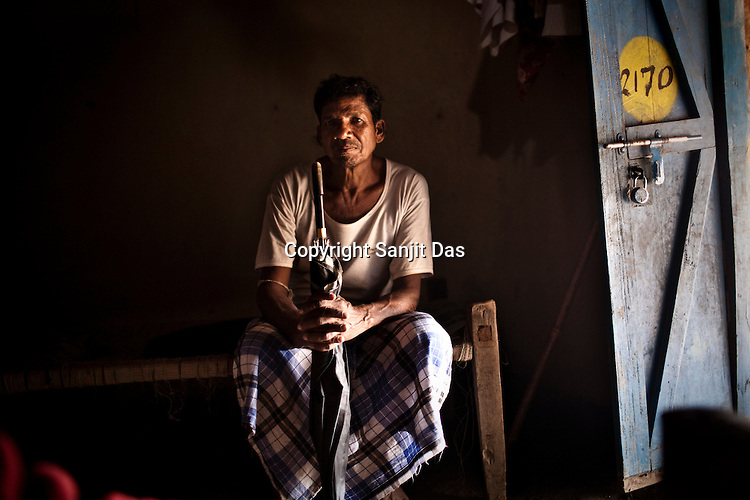 Varse Malla from the Dorna tribe poses for a portrait inside his small empty hut in  Dornapal, a Salwa Judum village in Chattisgarh, India. Photo: Sanjit Das/Panos for Forbes