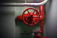 A dry standpipe in a stairwell in an occupied multiple dwelling on Thursday, January 26, 2012,  in the New York neighborhood of Chelsea. A standpipe is a dry line that the fire department connects to to deliver water to upper floors. (© Richard B. Levine)