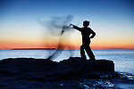 Woman attacking a ghost shadow of a man blurred silhouette over colorful twilight sky