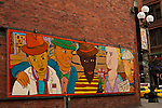 Downtown Seattle at Pioneer Square with mural on side of building