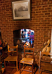 A wood-burning fireplace heats and illuminates both the tasting room at a nearby seating area at Barboursville Vineyards.