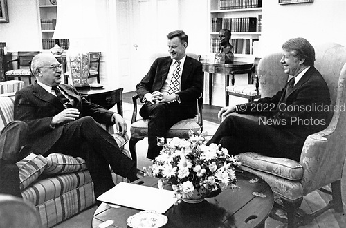 United States President Jimmy Carter, right, meets Ambassador of the USSR Anatoliy F. Dobrynin, left, and National Security Advisor Zbigniew Brzezinski, center, in the Oval Office of the White House in Washington, DC on April 12, 1977.  They met to discuss the SALT talks and other matters.<br /> Credit: White House via CNP