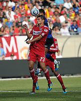 Chicago Fire defender Josip Mikulic (23) heads the ball while being pressured by Manchester United midfielder Nani (17).  Manchester United defeated the Chicago Fire 3-1 at Soldier Field in Chicago, IL on July 23, 2011.