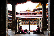 Buddhist monks sit and talk while one plays with a mobile phone inside the Punakha Dzong in Punakha, the older capital of Bhutan. Punakha is the administrative centre of Punakha dzongkhag, one of the 20 districts of Bhutan. Photo: Sanjit Das/Panos