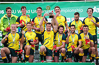 The victorious Australia Men's team celebrate with the World University Championship Rugby Sevens trophy. FISU World University Championship Rugby Sevens Closing Ceremony on July 9, 2016 at the Swansea University International Sports Village in Swansea, Wales. Photo by: Patrick Khachfe / Onside Images