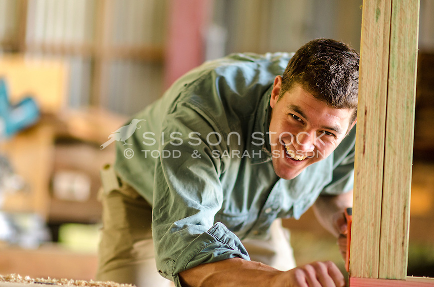 New Zealand Photos | Young carpenter smiling on the job, NZ - stock photo, canvas, fine art print