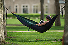May 12, 2014; Mechanical engineering and industrial design student, John Wetzel relaxes in his hammock. Photo by Barbara Johnston/University of Notre Dame