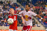 Richard Eckersley (27)  of Toronto FCand Wilman Conde (2) of the New York Red Bulls during a Major League Soccer (MLS) match at Red Bull Arena in Harrison, NJ, on September 29, 2012.