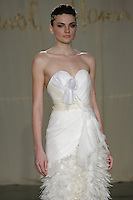 Model walks runway in a Hemlock wedding dress by Carol Hannah Whitfield, for the Carol Hannah Spring Summer 2012 Bridal collection runway show.