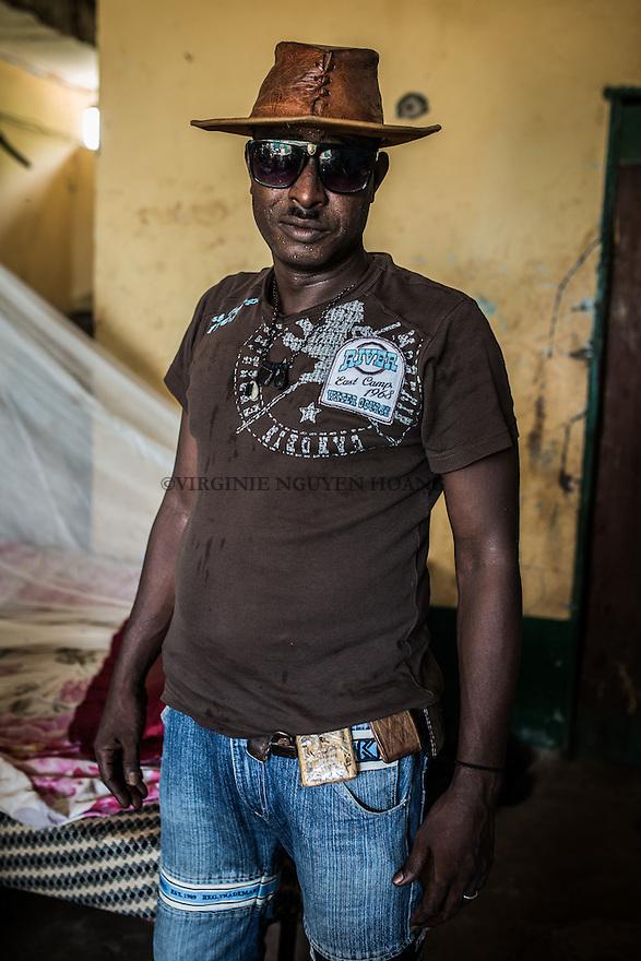 CAR, Bangui: Force Amimeri is posing in the headquarter of the Auto-Defense in the PK5 neighbourhood of Bangui. Force is the etat major of the auto-defense and pose often with his hats. 14th of April 2016<br /> <br /> RCA, Bangui : Force Amimeri pose dans le QG de l' Auto -d&eacute;fense dans le quartier  PK5 de Bangui . Force est l' Etat Major de l'auto- d&eacute;fense et pose souvent avec ses chapeaux.  14 Avril 2016
