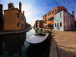 A early morning view of Fondamenta Cavanella in Burano, with one of the many canals of the island and the unmistalkable colorful houses. Taken a morning of mid December, this is stitched from four veritcal takes for better resolution and perspective distortion correction.