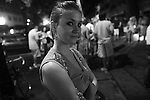 A woman poses for a quick sidewalk portrait at the Bragg Jam Music Festival in Macon, Ga. July 31, 2010.