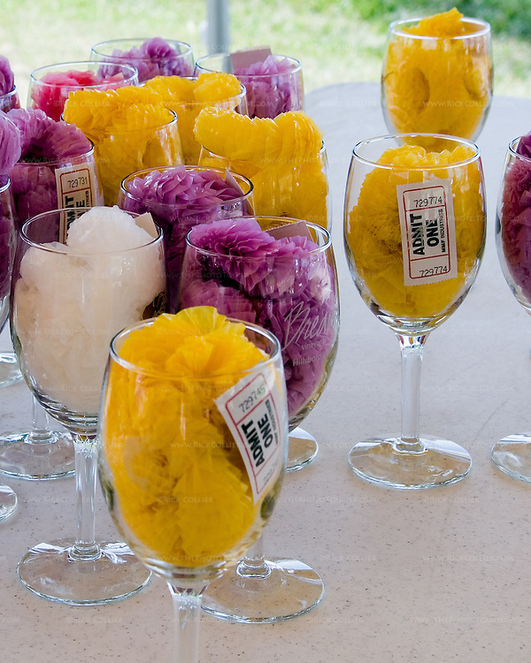 New arrivals at the annual Key West Fest at Breaux Vineyards receive a wine glass stuffed with entry ticket and a plastic lei.