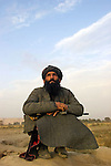 "An afghan mujahideen known as ""The Arab"" watches B52's fly past en route to attacking Taliban positions."
