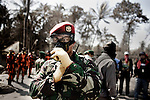 Search and rescue teams, and Indonesia's special military unit, Kopassus, look for dead bodies or survivors, in a river community that was home to 200 villagers, about 8 kilometers, or about 5 miles, from Mount Merapi, outside of Yogyakarta, Indonesia, on Wednesday, Nov. 11, 2010.
