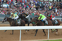 HOT SPRINGS, AR - APRIL 15: Classic Empire #2, with jockey Julien Leparoux fighting off Conquest Mo Money #11, with jockey Jorge Carreno, Sonneteer #7, with jockey Kent Desormeaux, and Lookin At Lee #6, with jockey Luis Contreras before crossing the finish line in the Arkansas Derby at Oaklawn Park on April 15, 2017 in Hot Springs, Arkansas. (Photo by Justin Manning/Eclipse Sportswire/Getty Images)