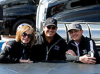 Mar 30, 2014; Las Vegas, NV, USA; NHRA top fuel driver Steve Torrence (right) with father Billy Torrence and mother Kay Torrence  during the Summitracing.com Nationals at The Strip at Las Vegas Motor Speedway. Mandatory Credit: Mark J. Rebilas-