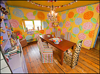 BNPS.co.uk (01202 558833)<br /> Pic: PhilYeomans/BNPS<br /> <br /> Colourful dining room.<br /> <br /> Britain's wackiest property has come on the market...And the estate agents mantra of paint everything magnolia has definately not been applied.<br /> <br /> It may look like an idyllic cottage in the Forest of Dean from the outside but ceramic artist Mary Rose Young's unique taste has transformed the interior into what looks like something from Alice in Wonderland.<br /> <br /> The three-bedroomed house is decorated from head to toe in crazy colours, clashing patterns, and enormous murals,<br /> each room is covered in the garish designs, including the bathroom, where even the sink and toilet have been adorned in bright tiles.<br /> <br /> Estate agents Bidmead Cook now have the tricky task of showing prospective punters round the &pound;500,000 property.