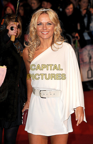 GERI HALLIWELL.Arrivals the Brit Awards 2010 held at Earls Court, London, England..February 16th 2010 .Brits half length white one shoulder sleeve dress grecian tanned tiara hairband hair head band headband.CAP/BEL.©Tom Belcher/Capital Pictures.