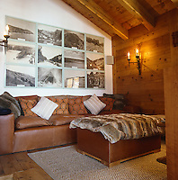 A series of photographs of south-west England from a collection at the Natural History Museum hangs on the wall above the sofa in the snug