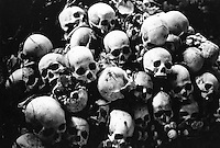 A pile of skulls in the caves of Phnom Sampeou, where thousands of people were murdered by the Khmer Rouge. Nearly 2 million people died under the Khmer through overwork, starvation or execution.