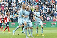 Sporting KC players celebrate Claudio Bieler's converted penalty kick..Sporting Kansas City defeated Chivas USA 4-0 at Sporting Park, Kansas City, Kansas.