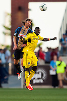 Jeff Parke (31) of the Philadelphia Union goes up for a header with Dominic Oduro (11) of the Columbus Crew. The Philadelphia Union defeated the Columbus Crew 3-0 during a Major League Soccer (MLS) match at PPL Park in Chester, PA, on June 5, 2013.