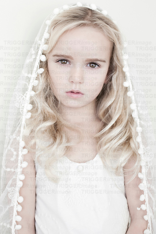 Female child with white lace veil