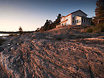 Sunset scenery of a cottage house on a beautiful rocky shore
