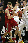 Davidson's Peyton Aldridge (23) grabs a loose ball against Iowa during 2015 NCAA Division I Men's Basketball Championship March 20, 2015 at the Key Arena in Seattle, Washington.  Iowa beat Davidson 83-52.   ©2015. Jim Bryant Photo. ALL RIGHTS RESERVED.