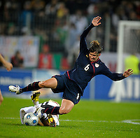Amy LePeilbet (6) falls after the tackle from Anja Mittag. US Women's National Team defeated Germany 1-0 at Impuls Arena in Augsburg, Germany on October 27, 2009.