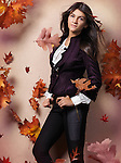 Teenage girl in fashionable clothes and red falling autumn leaves beautiful artistic fall fashion photo