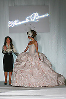 Fashion designer Katerina Bocci poses with model, at the close of her Bridal Fashion show, during the Wedding Trendspot Spring 2011 Press Fashion, October 17, 2010.