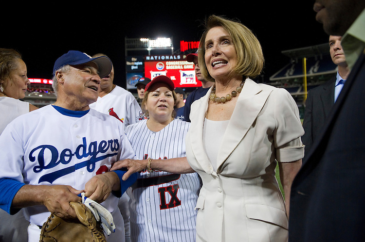 UNITED STATES - JULY 14: Rep. Joe Baca, D-Calif., Rep. Linda Sanchez, D-Calif., and House Minority Leader Nancy Pelosi, D-Calif., after the Democrats won the 50th Annual Roll Call Congressional Baseball Game held at Nationals Stadium, July 14, 2011. (Photo By Scott J. Ferrell/Roll Call)