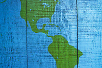 A map of North and South america painted on a wooden wall