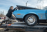 NWA Democrat-Gazette/ANTHONY REYES @NWATONYR<br /> Jerry Taplin, owner of Cars, Guitars and Antiques, pops the hood of his 1972 Ford Gran Torino Friday, Feb. 10, 2017 as he loads it onto a trailer near his shop in downtown Bentonville. Tapin plans on trading the Torino for a 1946 Chrysler New Yorker.