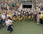 Aug. 31, 2013; Brian Kelly leads the football team out of the tunnel for the Temple game.<br /> <br /> Photo by Matt Cashore