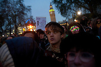 Protestors stand outside the Houses of Parliament during a student demonstration in Westminster, central London on the day the government passed a bill to increase university tuition fees.
