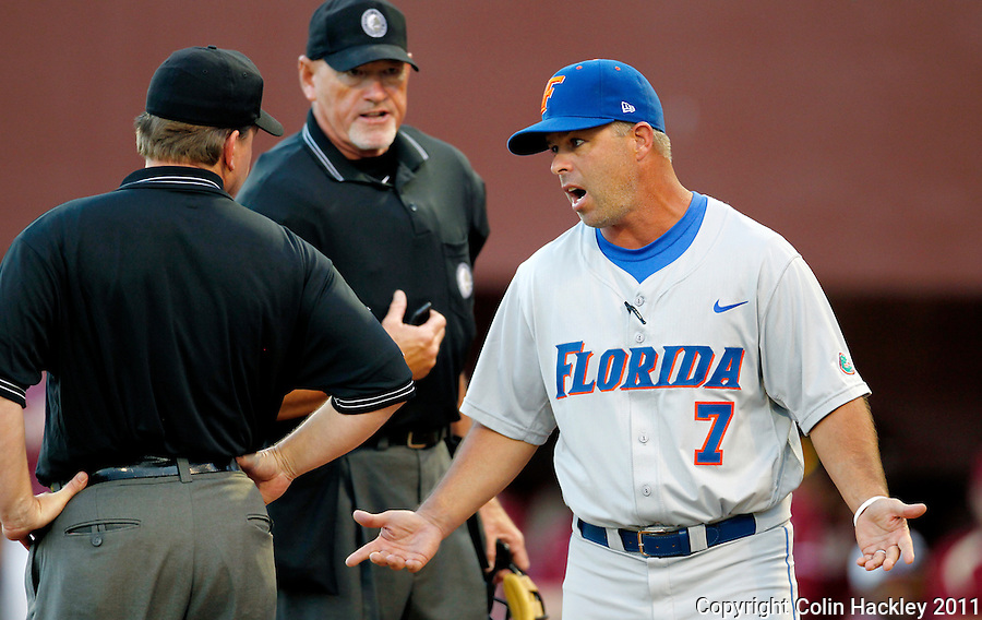 TALLAHASSEE, FL 4/12/11-FSU-UF BASE11 CH-Florida Head Coach Kevin O'Sullivan, right, complains about a call after Florida State scored the first of two runs off wild pitches during seventh inning action Tuesday at Dick Howser Stadium in Tallahassee. The Seminoles beat the Gators 3-1. COLIN HACKLEY PHOTO