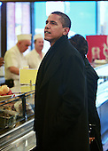 Chicago, Il - November 21, 2008 -- United States President-elect Barack Obama orders a sandwich at Manny's Coffee Shop and Deli during a lunch break from his transition office at the federal building, Friday, November 21, 2008 in Chicago, Illinois. Obama ordered a corned beef sandwich and greeted customers before leaving the restaurant.  .Credit: Scott Olson - Pool via CNP