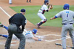 Ole Miss vs. Memphis' Derrick Thomas (24) is safe at home at Oxford-University Stadium in Oxford, Miss. on Tuesday, February 28, 2012. Ole Miss won 7-2.